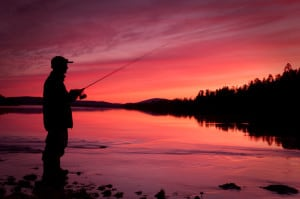 Fishing spinning at sunset. Silhouette of a fisherman