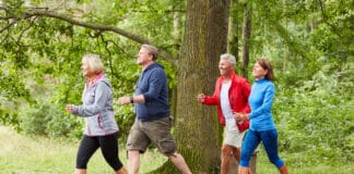 Group of seniors walking or walking as a fitness training in nature