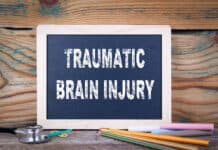 traumatic brain injury. Chalkboard on a wooden background.