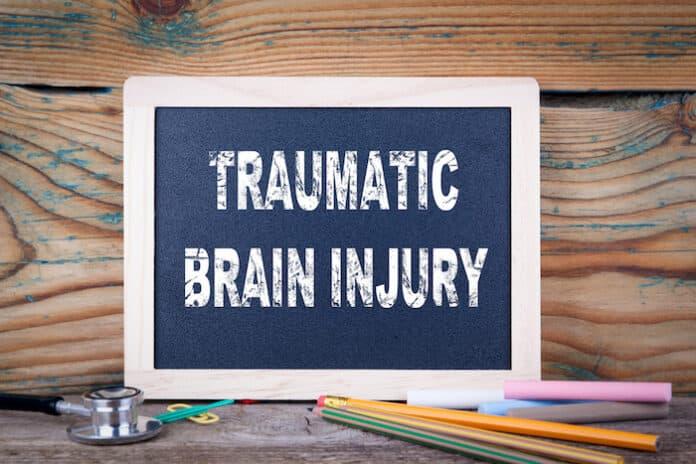 traumatic brain injury. Chalkboard on a wooden background.